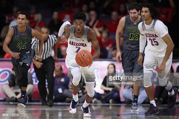 Kobi Simmons of the Arizona Wildcats moves the ball upcourt during the first half of the college basketball game against the UC Irvine Anteaters at...