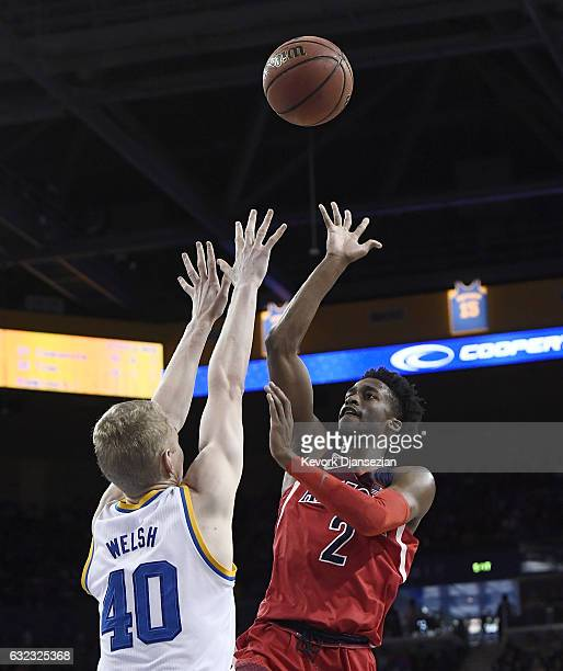Kobi Simmons of the Arizona Wildcats scores basket over Thomas Welsh of the UCLA Bruins during the second half of the game at Pauley Pavilion on...