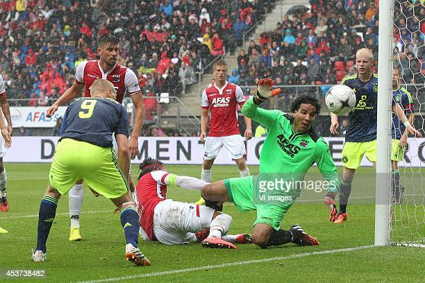Kobleinn Sigthorsson of Ajax Nemanja Gudelj of AZ Esteban of AZ during the Dutch Eredivisie match between AZ Alkmaar and Ajax Amsterdam at AFAS...