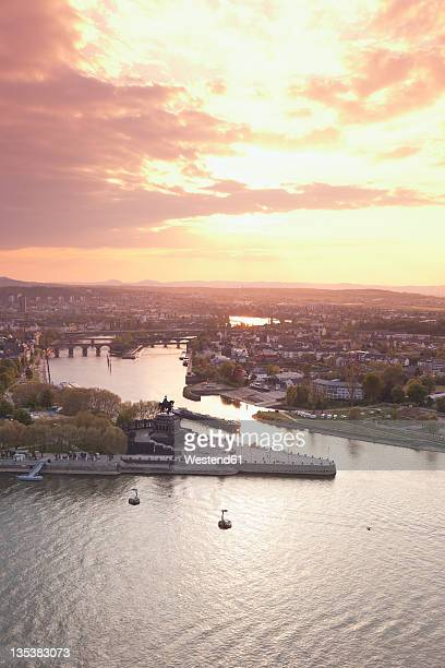 Koblenz, Ehrenbreitstein, View of Deutsches Eck with cable car crossing two rivers at sunset