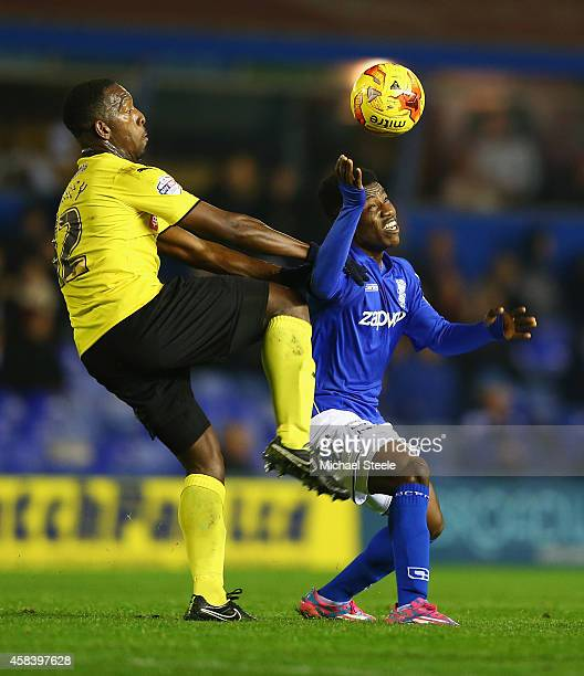 Koby Arthur of Birmingham City is challenged by Lloyd Doyley of Watford during the Sky Bet Championship match between Birmingham City and Watford at...