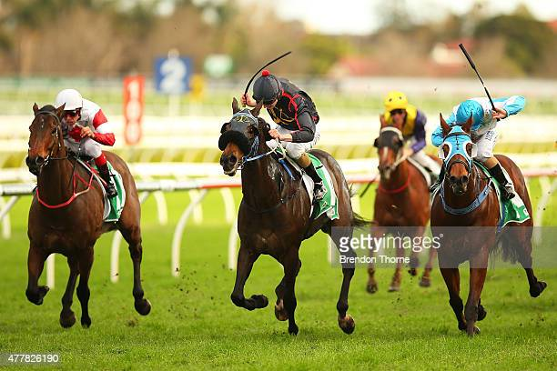 Koby Jennings riding 'Aroused' wins Race 7 TAB Rewards Handicap during Sydney Racing at Royal Randwick Racecourse on June 20 2015 in Sydney Australia
