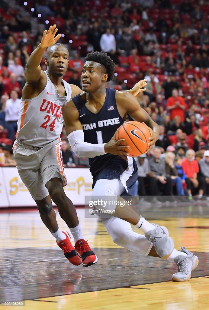 Koby McEwen #1 of the Utah State Aggies drives against Jordan Johnson #24 of the UNLV Rebels during their game at the Thomas & Mack Center on January 6, 2018 in Las Vegas, Nevada. Utah State won 85-78.
