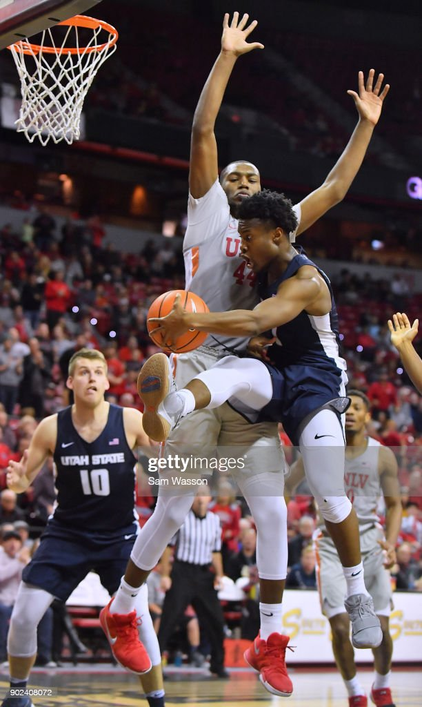 Koby McEwen #1 of the Utah State Aggies passes the ball against Brandon McCoy #44 of the UNLV Rebels during their game at the Thomas & Mack Center on January 6, 2018 in Las Vegas, Nevada. Utah State won 85-78.