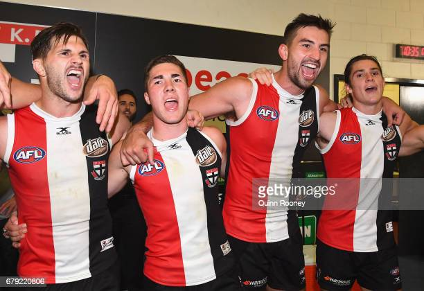Koby Stevens Jade Gresham Billy Longer and Jack Steele of the Saints sing the song after winning the round seven AFL match between the St Kilda...