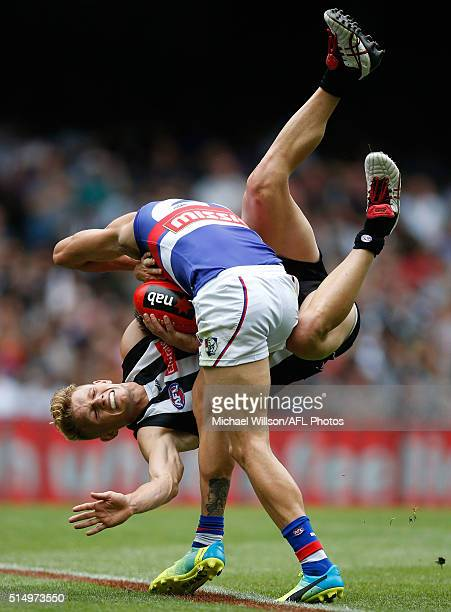 Koby Stevens of the Bulldogs is tackled by Adam Treloar of the Magpies during the 2016 NAB Challenge match between the Collingwood Magpies and the...