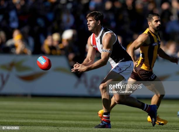 Koby Stevens of the Saints handballs during the round six AFL match between the Hawthorn Hawks and the St Kilda Saints at University of Tasmania...