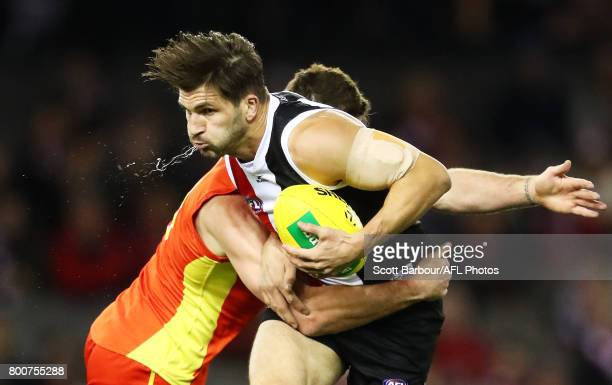 Koby Stevens of the Saints is tackled during the round 14 AFL match between the St Kilda Saints and the Gold Coast Suns at Etihad Stadium on June 25...
