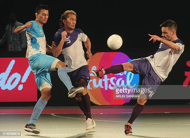 Kochi's Deives Moraes and Miguel Salgado play against Mumbai 5's Angellot during their Premier Futsal Football League match in Chennai on July 16...