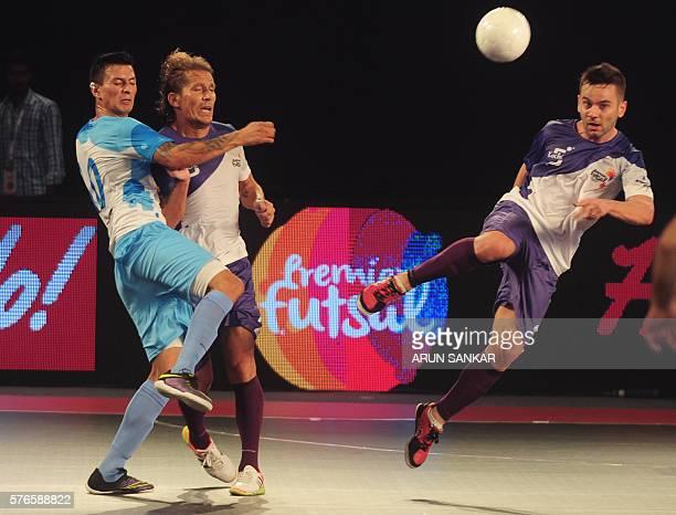 Kochi's Deives Moraes Miguel Salgado plays against Mumbai 5's Angellot during their Premier Futsal Football League match in Chennai on July 16 2016 /...