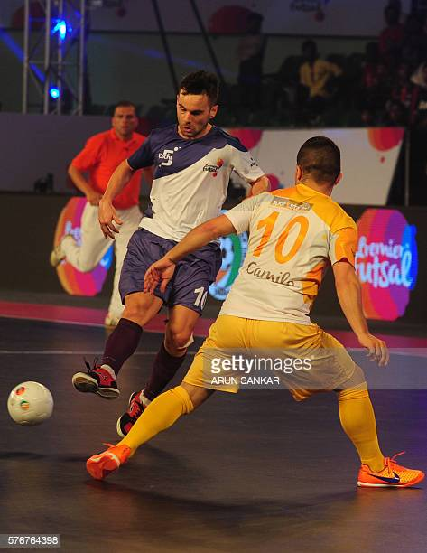 Kochi's Deives Moraes plays against Chennai 5's Camilo during their Premier Futsal Football League match in Chennai on July 17 2016 / AFP / ARUN...