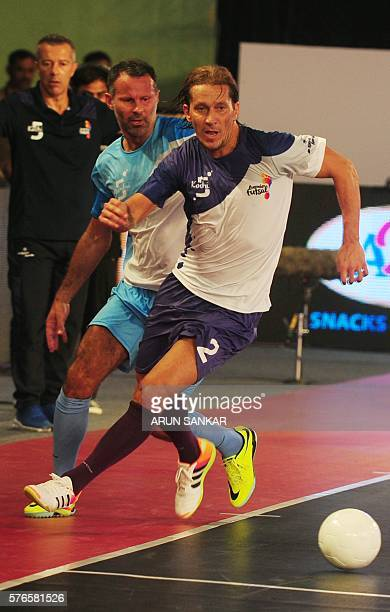 Kochi's Miguel Salgado plays against Rayan Gibbs of the Mumbai 5's during their Premier Futsal Football League match in Chennai on July 16 2016 / AFP...