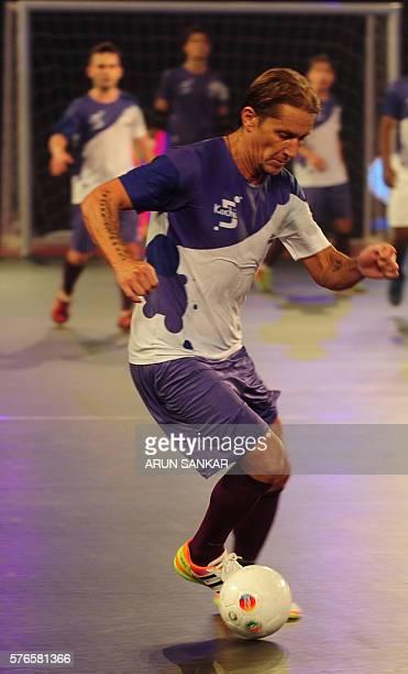 Kochi's Miguel Salgado scores a goal against the Mumbai 5's during their Premier Futsal Football League match in Chennai on July 16 2016 / AFP / ARUN...