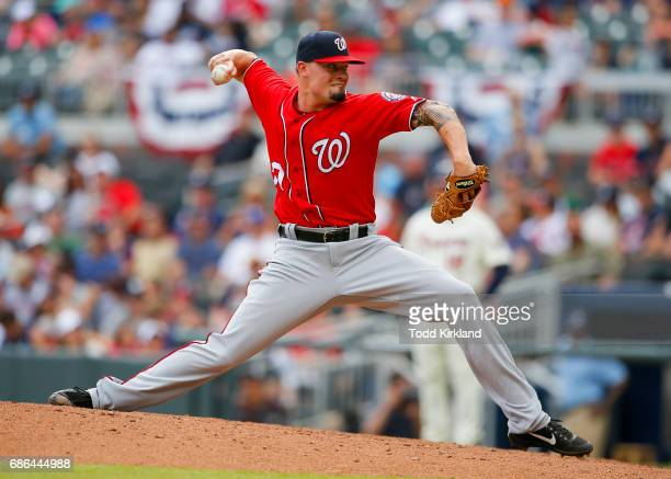 Koda Glover of the Washington Nationals pitches in relief in the ninth inning of an MLB game against the Atlanta Braves at SunTrust Park on May 21...
