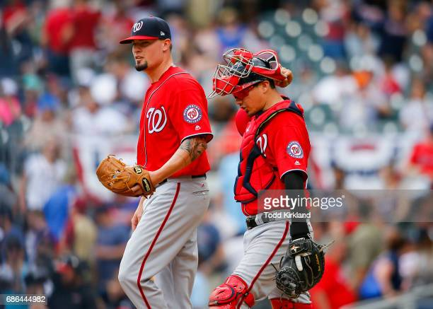 Koda Glover of the Washington Nationals reacts with Jose Lobaton at the conclusion of an MLB game against the Atlanta Braves at SunTrust Park on May...