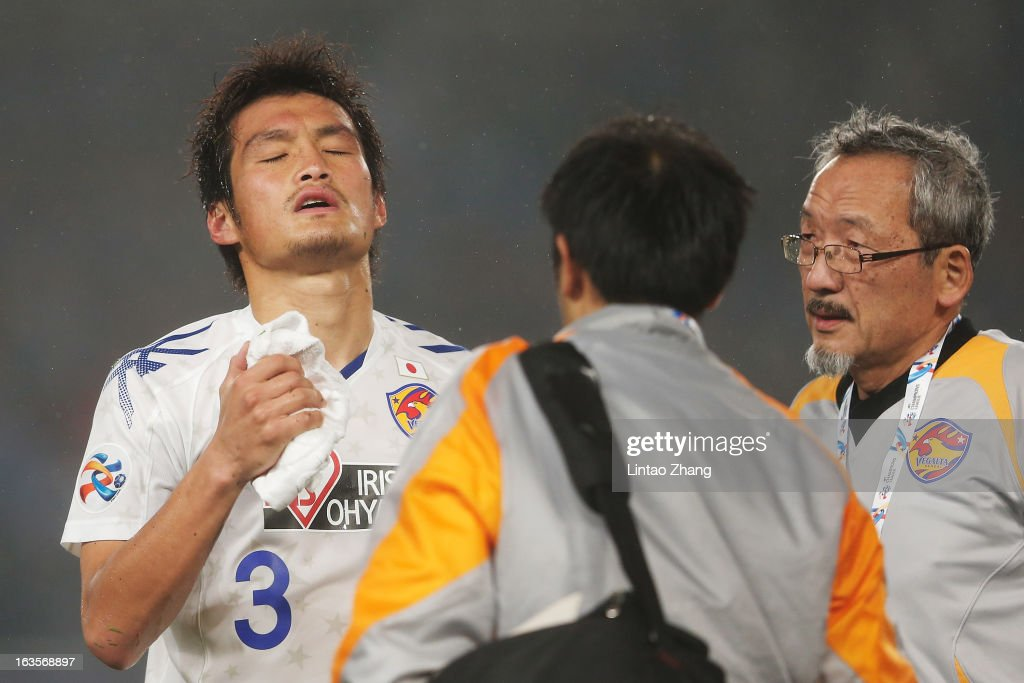 Kodai Watanabe of Vegalta Sendai reacts with team doctor during the AFC Champions League match between Jiangsu Sainty and Vegalta Sendai at Nanjing Olympic Sports Center Stadium on March 12, 2013 in Nanjing, China.