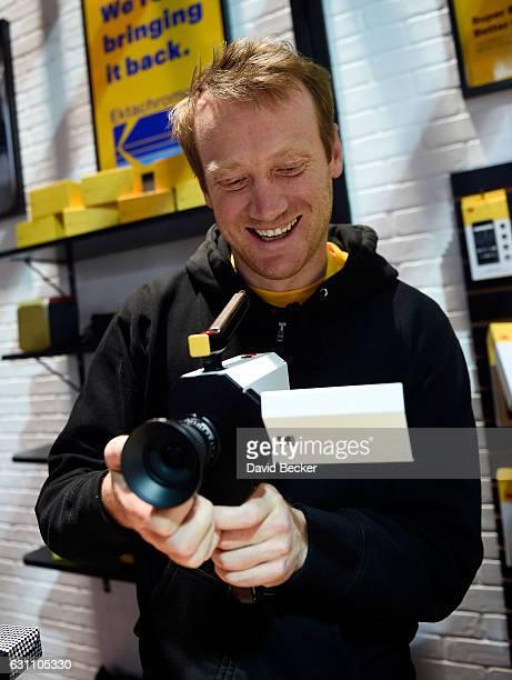 Kodak representative Josh Robertson demostrates Kodak's new Super 8 movie camera at CES 2017 at the Las Vegas Convention Center on January 6 2017 in...