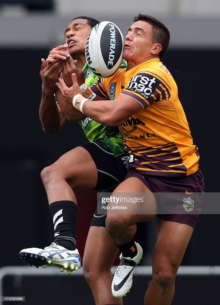 Kodi Nikorima of the Broncos and Glenn Fisiiahi of the Warriors compete for the ball during the NRL trial match between the Brisbane Broncos and the New Zealand Warriors at Forsyth Barr Stadium on February 23, 2014 in Dunedin, New Zealand.