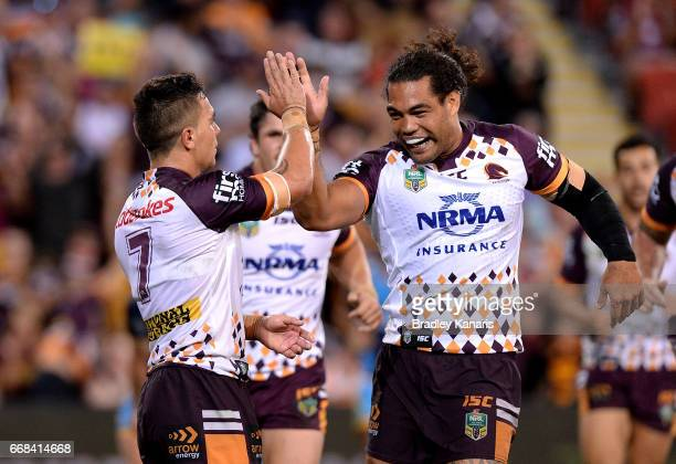 Kodi Nikorima of the Broncos celebrates with Adam Blair after scoring a try during the round seven NRL match between the Brisbane Broncos and the...