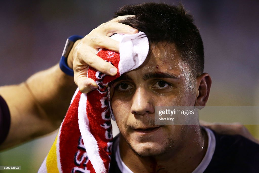 Kodi Nikorima of the Broncos is assisted by medical staff after sustaining a facial cut during the round nine NRL match between the Cronulla Sharks and the Brisbane Broncos at Southern Cross Group Stadium on May 1, 2016 in Sydney, Australia.