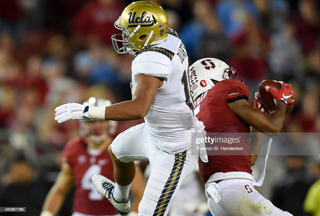 Kodi Whitfield #5 of the Stanford Cardinal's intercepts a pass intended for Thomas Duarte #18 of the UCLA Bruins in the third quarter of an NCAA football game at Stanford Stadium on October 15, 2015 in Stanford, California.
