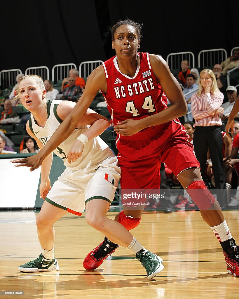 Kody Burke #44 of the North Carolina State Wolfpack nd Stefanie Yderstrom #3 of the Miami Hurricanes battle for position on December 20, 2012 at the BankUnited Center in Coral Gables, Florida. The Hurricanes defeated the Wolfpack 79-53.