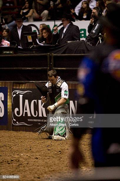 Kody Lostroh says a prayer after getting bucked off of his bull Big Tex
