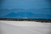 a view of Koeberg power Plant beneath Table Mountain from Atlantis dunes