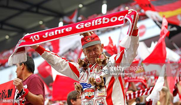 Koeln Fan wave a scarf during the Bundesliga match between 1 FC Koeln and VfL Wolfsburg at RheinEnergieStadion on August 22 2015 in Cologne Germany