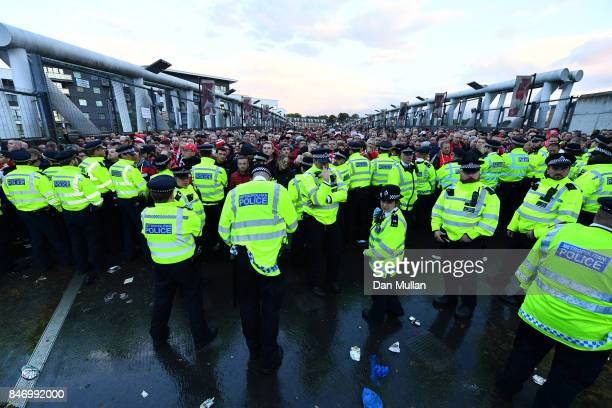 Koeln fans are held by police ahead of arriving at the Emirates Stadium prior to the UEFA Europa League group H match between Arsenal FC and 1 FC...