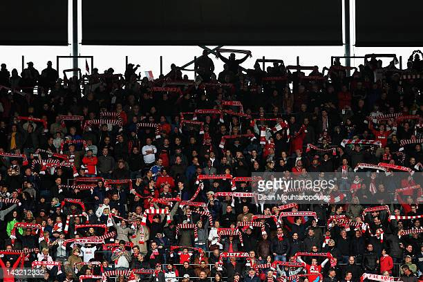 Koeln fans sing prior to the Bundesliga match between 1 FC Koeln and VfB Suttgart at RheinEnergieStadion on April 21 2012 in Cologne Germany