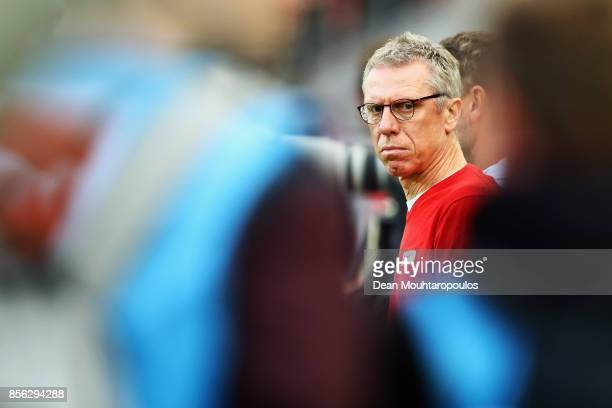 Koeln Manager / Head Coach Peter Stoger looks on during the Bundesliga match between 1 FC Koeln and RB Leipzig at RheinEnergieStadion on October 1...