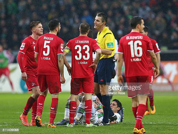 Koeln players argues with referee Knut Kircher during the Bundesliga match between Borussia Moenchengladbach and 1 FC Koeln at BorussiaPark on...
