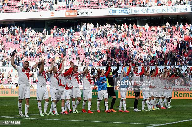 Koeln players celebrate after the Bundesliga match between 1 FC Koeln and 1899 Hoffenheim at RheinEnergieStadion on April 12 2015 in Cologne Germany