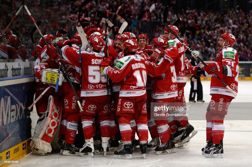 Koelner Haie players celebrate after winning game five of the DEL play-offs between Koelner Haie and Straubing Tigers at Lanxess Arena on February 28, 2013 in Cologne, Germany.