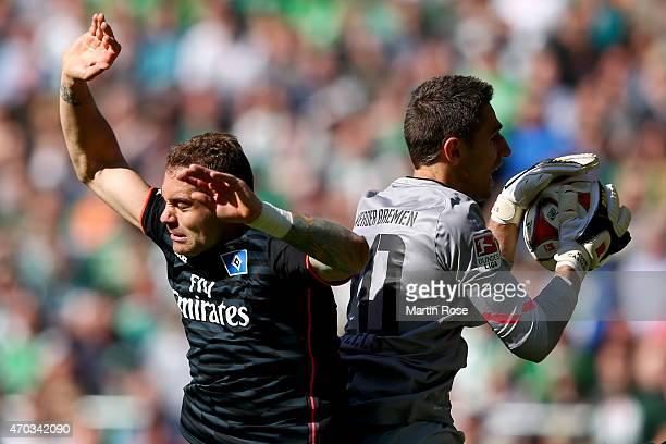 Koen Casteels keeper of Bremen safes the ball against PierreMichel Lasogga of Hamburg during the Bundesliga match between SV Werder Bremen and...
