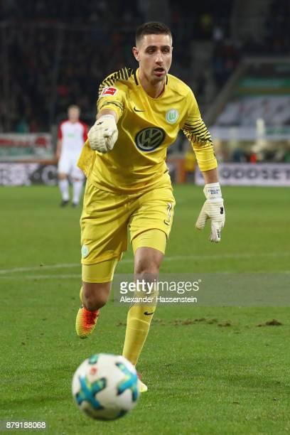 Koen Casteels keeper of Wolfsburg controlls the ball during the Bundesliga match between FC Augsburg and VfL Wolfsburg at WWKArena on November 25...
