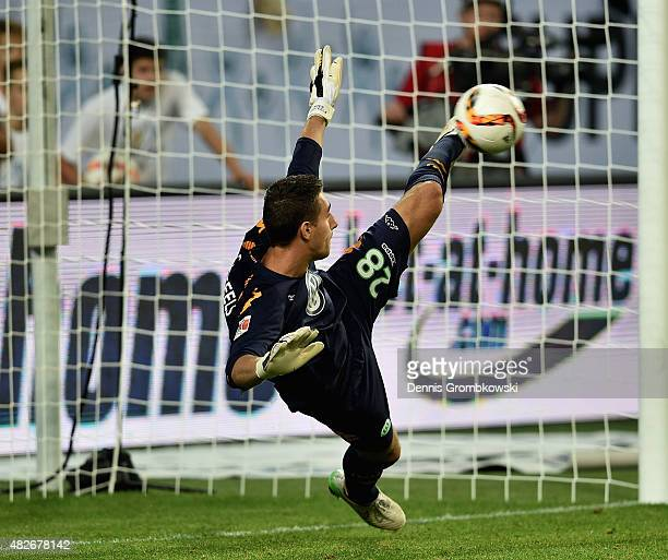 Koen Casteels of VfL Wolfsburg saves a penalty during the DFL Supercup 2015 match between VfL Wolfsburg and FC Bayern Muenchen at Volkswagen Arena on...