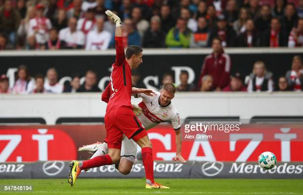 Koen Casteels of Wolfsburg fouls Simon Terodde of Stuttgart and receives a yellow card during the Bundesliga match between VfB Stuttgart and VfL...