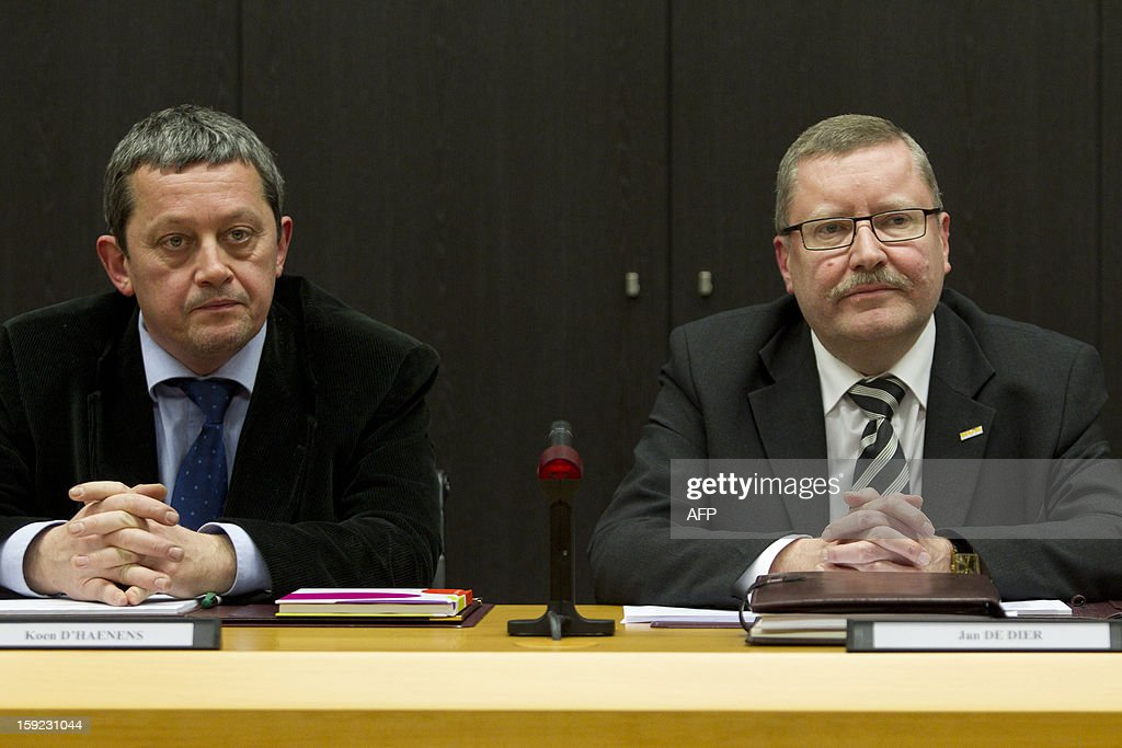 Koen D'Haenens (N-VA) and Jan De Dier (N-VA) are pictured during the installation of the new municipal council in Denderleeuw late on January 9, 2013. THE CD&V and N-VA parties agreed to form a minority coalition but will receive support from Flemish far-right party Vlaams Belang. By making this agreement the coalition is breaking the 'cordon sanitaire' agreement to not work with the Vlaams Belang party.