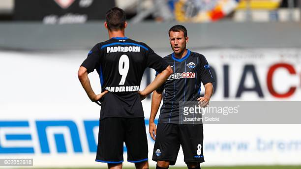 Koen van der Biezen and MarcAndre Kruska of Paderborn during the Third League match between SC Paderborn and Holstein Kiel at BentelerArena on...
