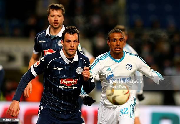 Koen van der Biezen of Bielefeld and Joel Matip of Schalke battle for the ball during the friendly match between Arminia Bielefeld and Schalke 04 at...