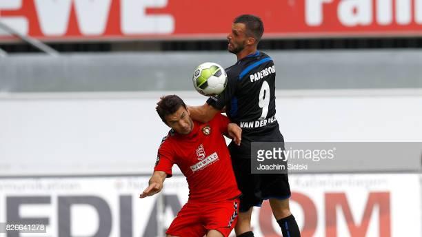 Koen van der Biezen of Paderborn challenges Shqiprim Binakaj of Sonnenhof Grossaspach during the 3 Liga match between SC Paderborn 07 and SG...