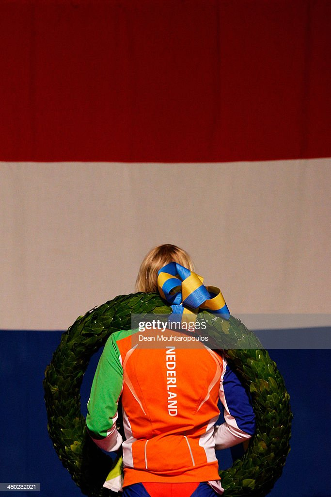 Koen Verweij of The Netherlands stands for the national anthem in front of the Dutch flag after winning the overall standings during day two of the Essent ISU World Allround Speed Skating Championships at the Thialf Stadium on March 23, 2014 in Heerenveen, Netherlands.