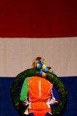 Koen Verweij of The Netherlands stands for the national anthem in front of the Dutch flag after winning the overall standings during day two of the...