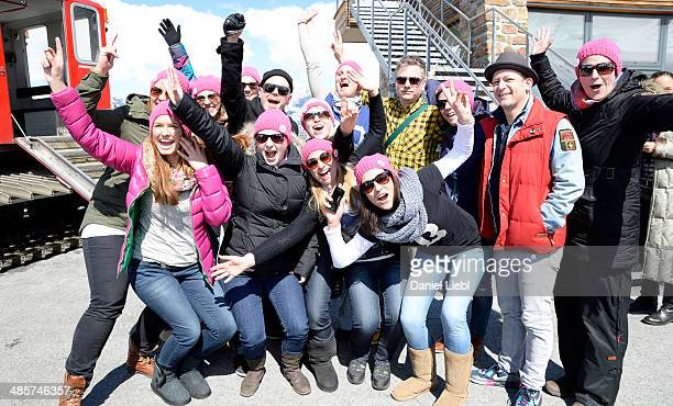 Koenig Boris Doktor Renz and Bjoern Beton of Fettes Brot pose with girls from Erfurt Germany at the 'Top of the Mountain Easter Concert' at Idalp on...