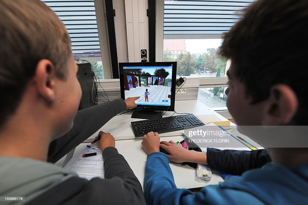 SIMON - Koerbele high school students use a computer software recreating an imaginary city, on October 10, 2012, in Selestat, eastern France.