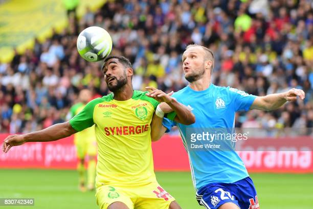Koffi Djidji of Nantes and Valere Germain of Marseille during the Ligue 1 match between FC Nantes and Olympique Marseille at Stade de la Beaujoire on...