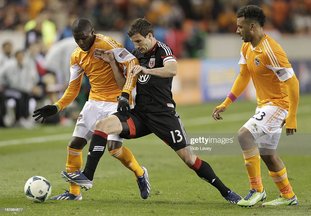 Kofi Sarkodie #8 of the Houston Dynamo controls the ball near the sideline as <a gi-track='captionPersonalityLinkClicked' href=/galleries/search?phrase=Chris+Pontius&family=editorial&specificpeople=595627 ng-click='$event.stopPropagation()'>Chris Pontius</a> #13 of the D.C. United applies pressure as Giles Barnes #23 looks on during second half action at BBVA Compass Stadium on March 2, 2013 in Houston, Texas. Houston won 2-0.