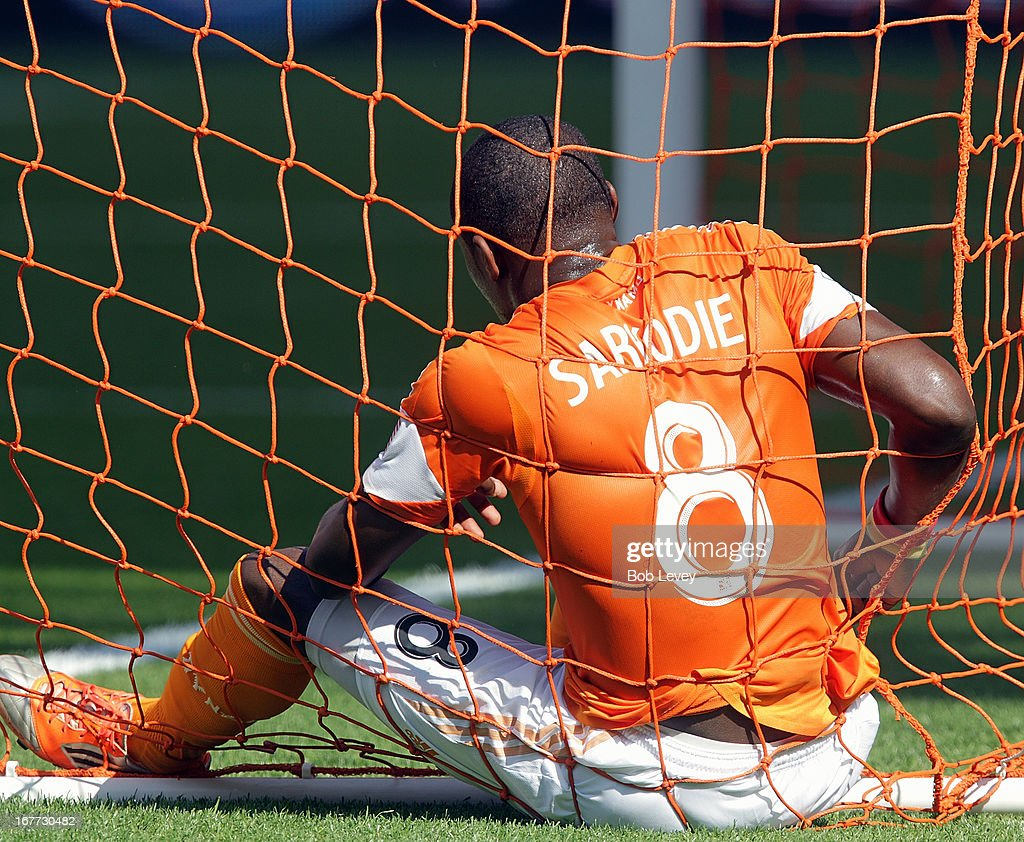 Kofi Sarkodie #8 of the Houston Dynamo sits in the goal after attempting to get his foot on a ball against the Colorado Rapids at BBVA Compass Stadium on April 28, 2013 in Houston, Texas.